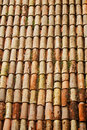 Red tiles pattern on traditional roof vertical shot background of Royalty Free Stock Image