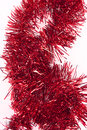 Red tinsel isolated on a white background Royalty Free Stock Image