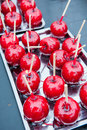 Red toffee apples selection of on a silver tray Stock Image