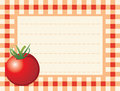 Red tomato on chequered background Royalty Free Stock Images