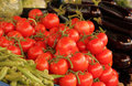 Red tomatoes and aubergines fresh on sale on a farmers market Stock Image