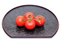 Red tomatoes bunch of on plate on white background Stock Photos