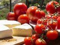 Red tomatoes with french cheese different varieties of fresh round Stock Photo