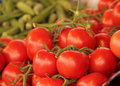 Red tomatoes fresh on sale on a farmers market Stock Image