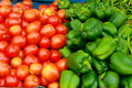 Red tomatoes and green capsicum Royalty Free Stock Photo