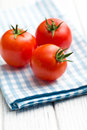 Red tomatoes on napkin checkered Royalty Free Stock Photography