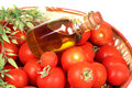 Red tomatoes and olive oil Royalty Free Stock Image