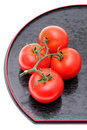 Red tomatoes on plate bunch of white background Royalty Free Stock Photo
