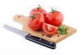 Red tomatoes on white background pile of ripe cutting board Stock Photography