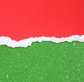 Red torn paper over green glitter background Stock Photography