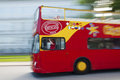 Red tour bus a bright tourist with motion blur background and people Royalty Free Stock Photos
