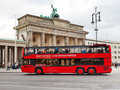 Red tourist double decker bus in berlin germany october near brandenburg gate on october the gate were built by carl gotthard Royalty Free Stock Images