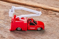 Red toy fire truck, wooden background. Royalty Free Stock Photo