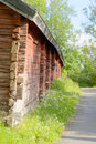 Red traditional wooden old barn and country road Royalty Free Stock Photo