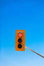 Red traffic light against blue sky with copyspace single demanding drivers to stop lots of Royalty Free Stock Photos