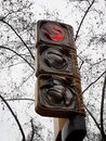 Red traffic light burned out after riots during a street demonstration. Royalty Free Stock Photo