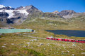 Red train of bernina st moritz switzerland august from tirano part the leading in switzerland st moritz are about km in an Royalty Free Stock Photo