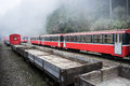 Red train on railway. Royalty Free Stock Photo