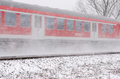 Red train with snow in winter Royalty Free Stock Photos