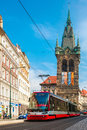 Red tram near Jindrisska Tower in Prague, Czech Royalty Free Stock Photo