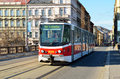 Red tram in prague city on the bridge public transportation wonderful of daytime Royalty Free Stock Photo