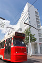 Red Tram, White Building Royalty Free Stock Image