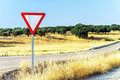 Red triangle road sign on natural background Stock Image