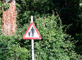 A red triangle street road sign with a man and child safety warn Royalty Free Stock Photo