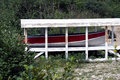 Red Trim Aluminum Boat In Boat Shelter On Beach Royalty Free Stock Photo
