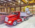 Red truck being loaded in the bay under ceiling lights Royalty Free Stock Photo