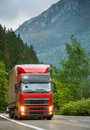 Red truck on mountain highway in the evening Royalty Free Stock Images