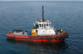 Red tug boat on  water Royalty Free Stock Photo
