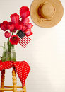 Red tulips, American flag and straw hat Royalty Free Stock Photo