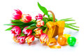 Red tulips flowers with easter eggs on a white background Stock Photos