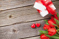 Red tulips and Valentine's day candy hearts Royalty Free Stock Photo