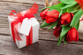 Red tulips and Valentine's day gift Royalty Free Stock Photo