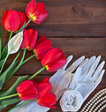 Red tulips and white lace gloves Royalty Free Stock Photo