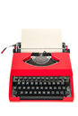 Red typewriter with blank paper vintage isolated over white background Royalty Free Stock Image