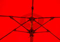 Red umbrella a close up of the interior of a large table Royalty Free Stock Photos