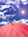 Red umbrella on sky background Stock Image