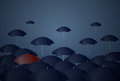 Red Umbrella Standing Out Of Crowd Individuality Concept Royalty Free Stock Photo