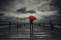 Red umbrella in storm Royalty Free Stock Photo