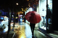 Red umbrella woman with walking in the rain Stock Photography