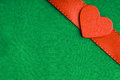 Red valentine heart on green cloth background s day wooden decorative love symbol textile with ribbon blank copy space Stock Photos