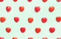 Red Valentine`s day heart candy pattern on green pastel paper color background. Love Concept. colorful hipster style. top view. Royalty Free Stock Photo