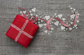 Red valentines present with checked ribbon and hearts on grey wo Royalty Free Stock Photo