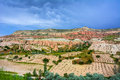 Red valley at Cappadocia, Anatolia, Turkey. Volcanic mountains i Royalty Free Stock Photo