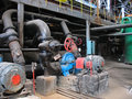 Red valve and electric water pumps at power plant Stock Photography