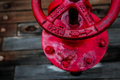 A red valve on the wooden deck of a battleship. Royalty Free Stock Photo