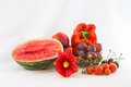 Red vegetables and fruit isolated group of fruits with glass flower Stock Photography